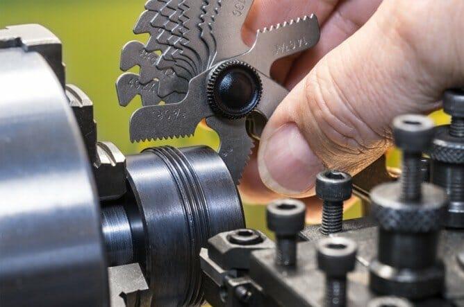 Engineer using tool.