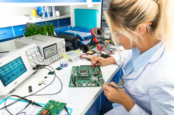 Electrical Engineer working on electrical system in lab