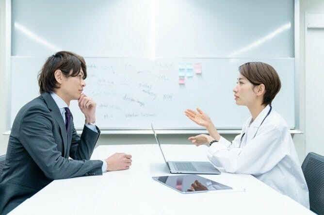 Health Care Operations Graduate student having a meeting with medical professional