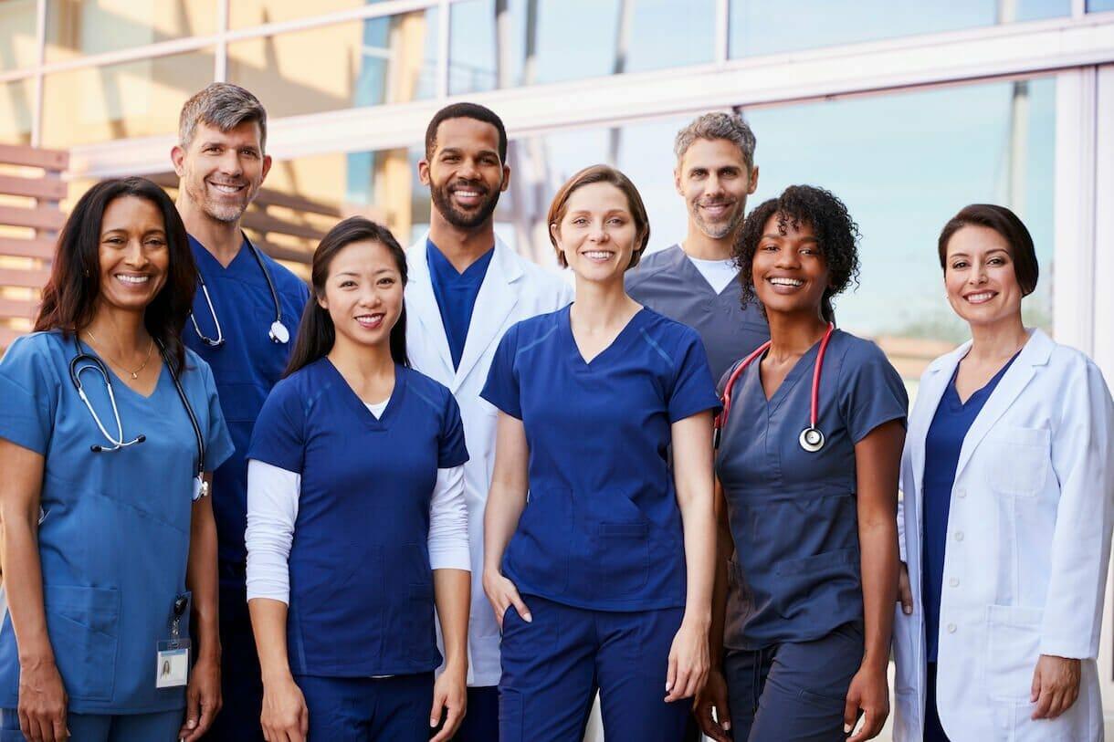 Health Informatics students facing camera smiling.