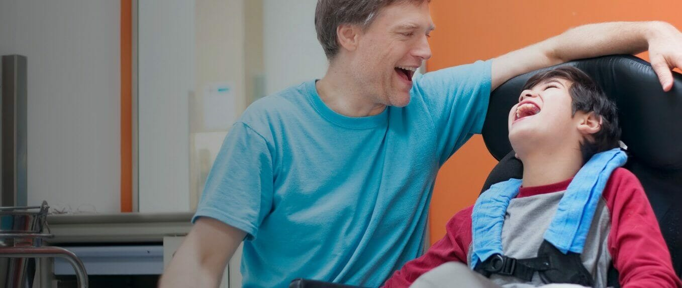 Man with child laughing