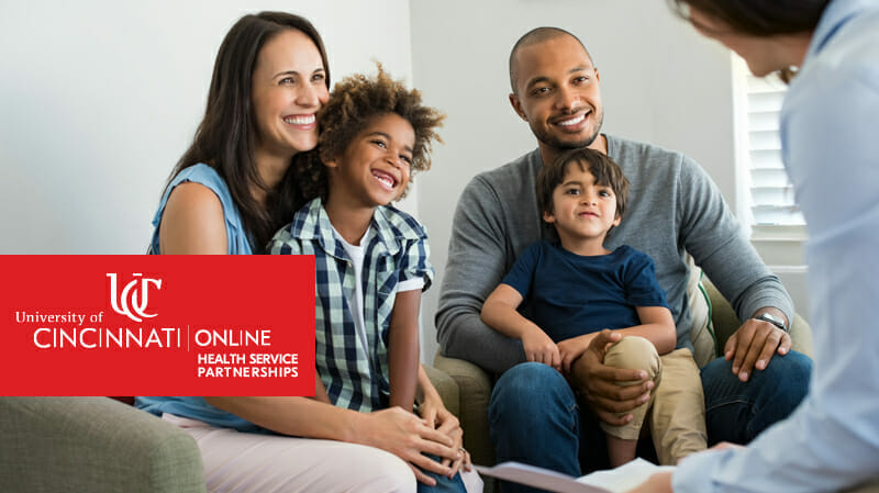 Smiling family talking to professional