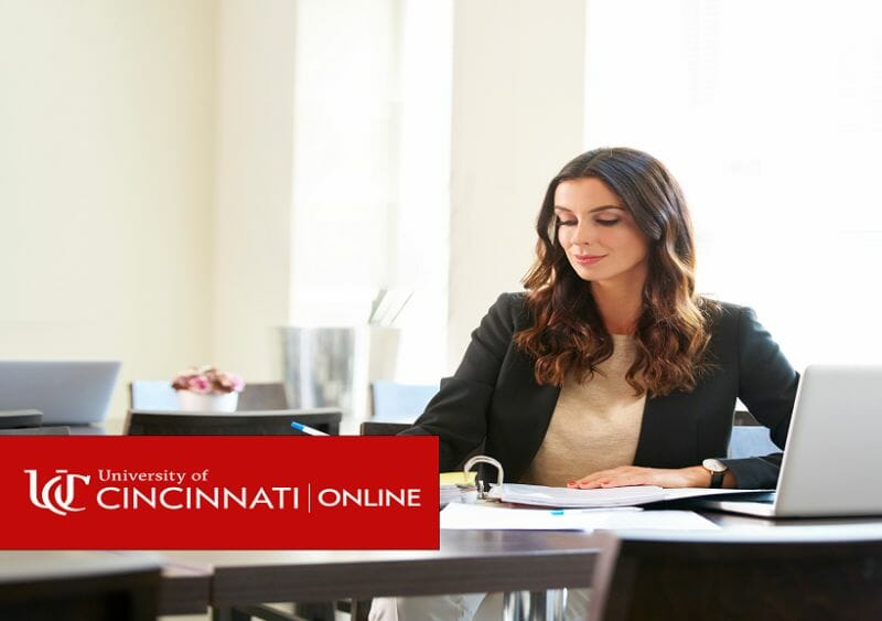 Woman sitting at desk working on laptop