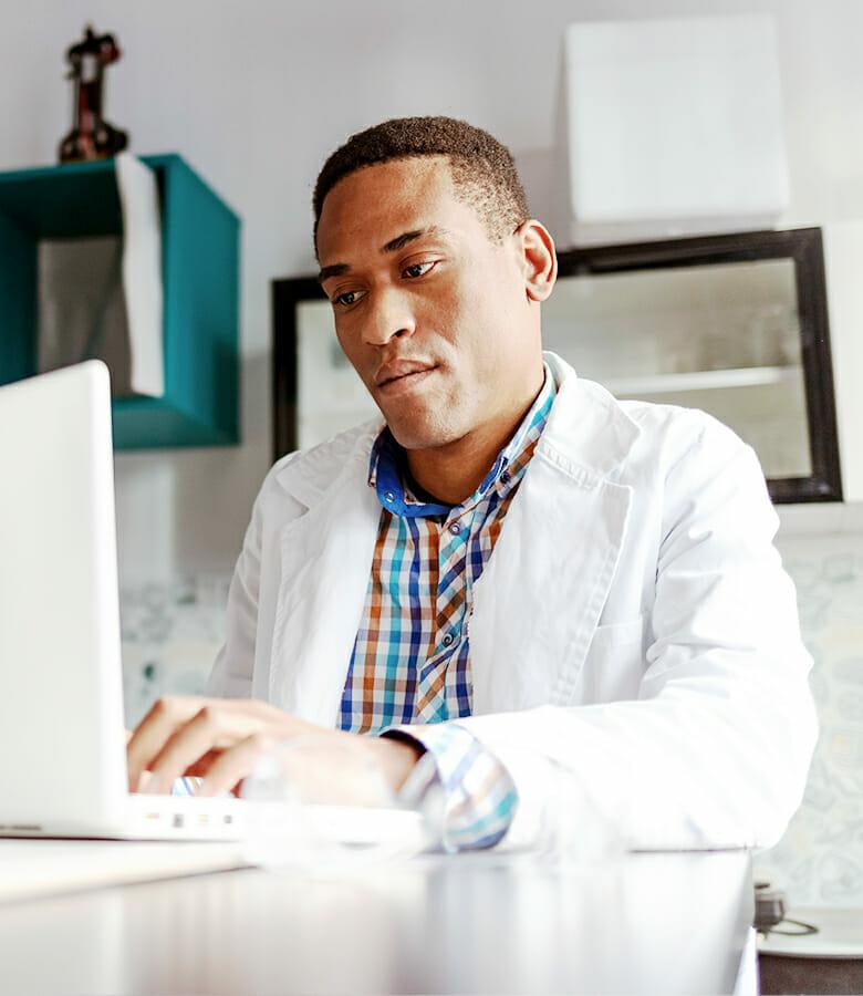 pharmacy student on laptop