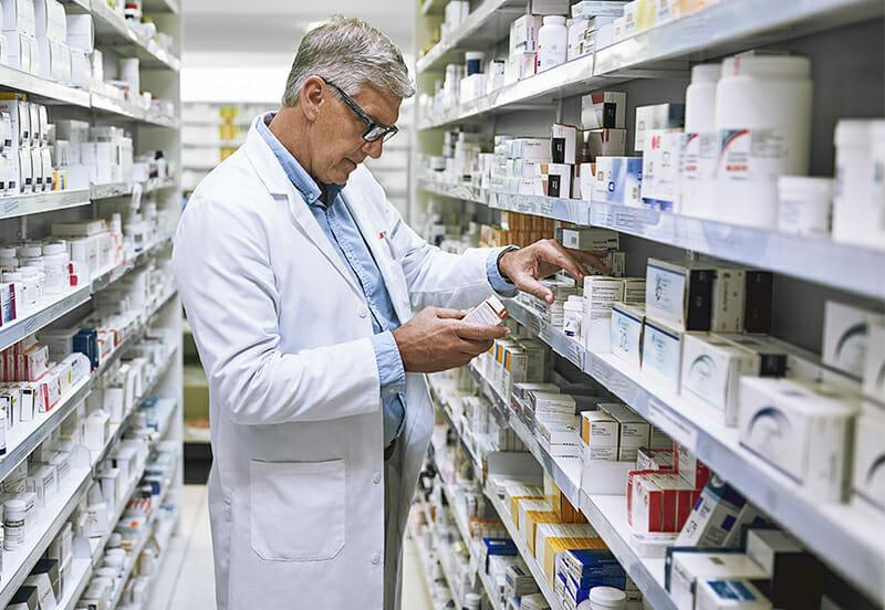Man picking out medication