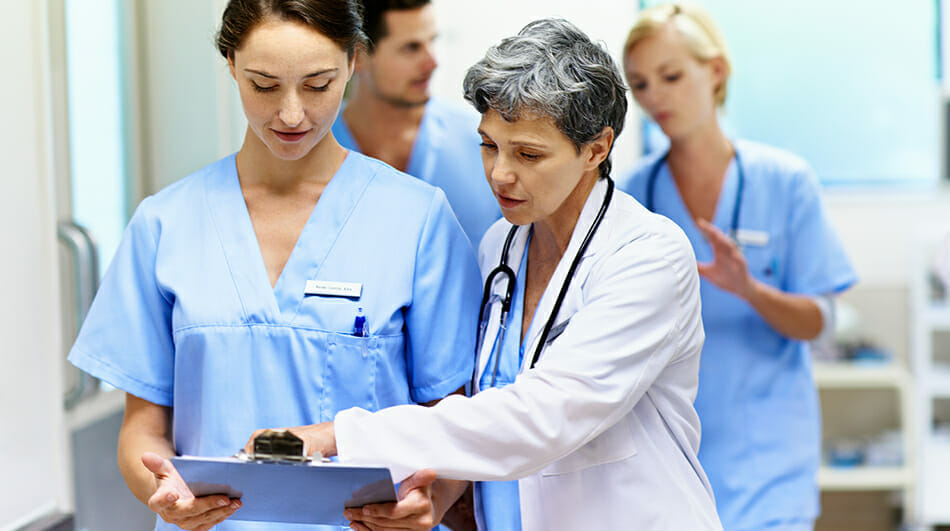 Nurse and doctor going over paperwork