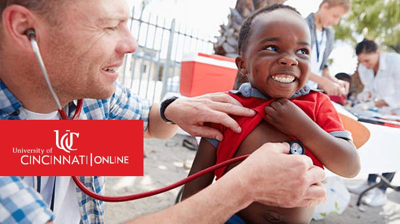 public health volunteer listening to kid's heartbeat