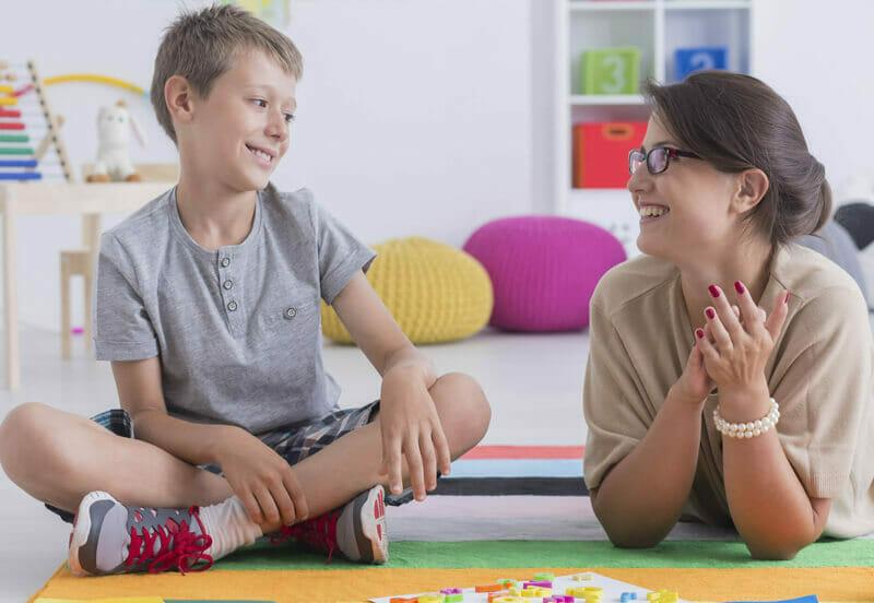 behavior analyst working with student
