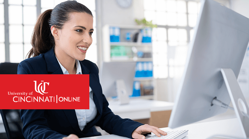 Woman working on computer in physician office
